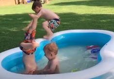 Funny Baby Playing With Water In The Pool